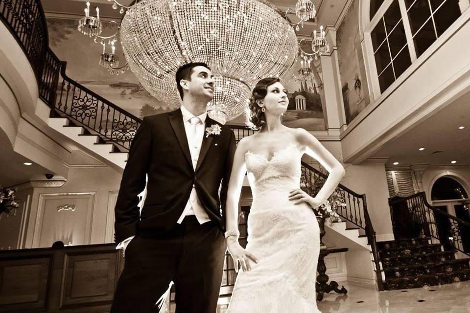 Poised newlywed couple