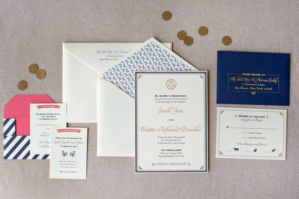 Gold, navy and coral wedding invitations