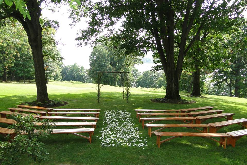 Natural wood benches in a ceremony setting