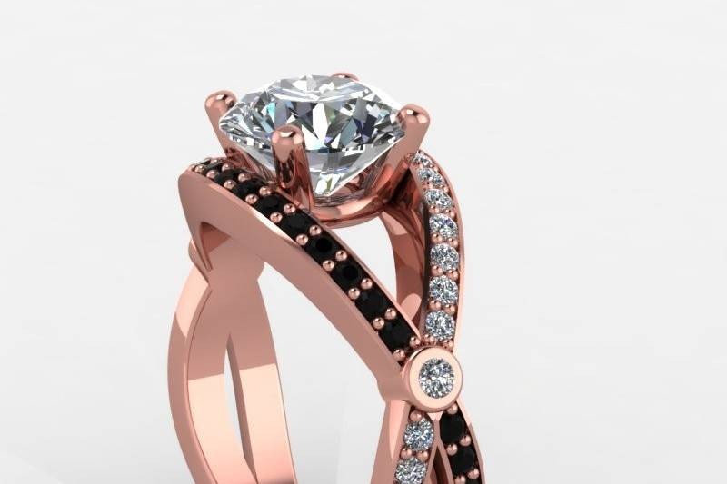 rose gold engagement ring with black and white diamonds.