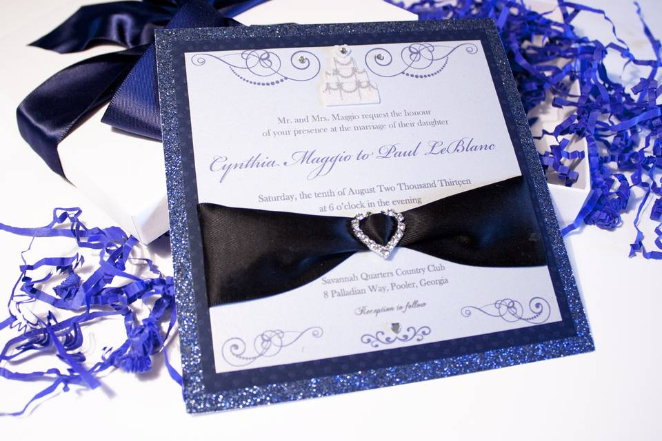 Custom Musical Wedding InvitationsThis stunning dark blue invitation features 3D embellishments, quality sparkle paper, large satin ribbon and crystal heart buckle. It comes in a box with matching ribbon and shred. Best of all, when the box opens, music plays! This invitation can be customized in your choice of colors and embellishments as well as music!