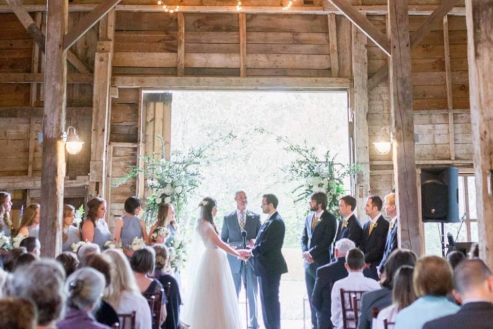 Ceremony inside of barn
