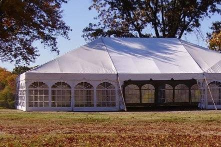 This photo is one of our 40x60 frame canopies with cathedral window side curtains.  We have frame tents as large as 40x100.  Frame tents have no center poles so you have more user space