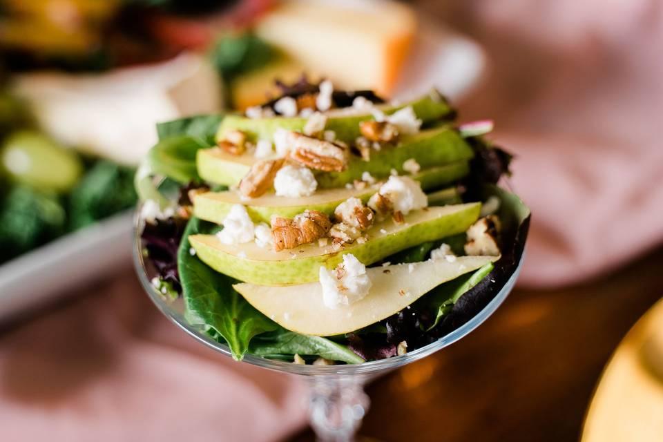 Salad in martini glasses.