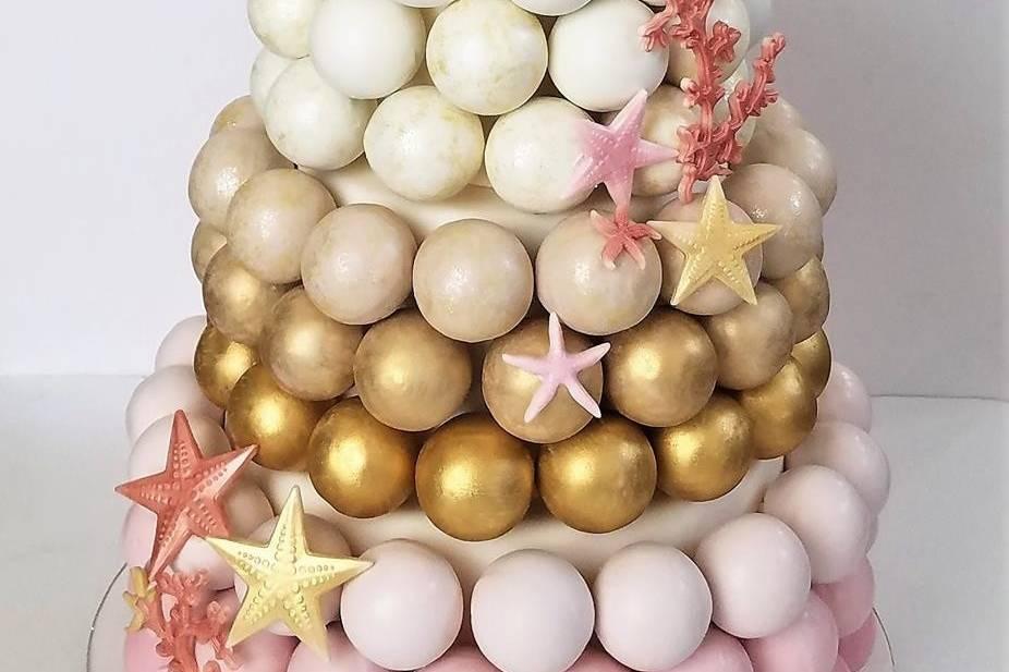 Beach-themed ombre wedding cake pop cake