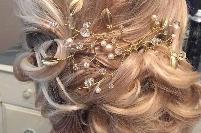Romantic wedding updo with accessory