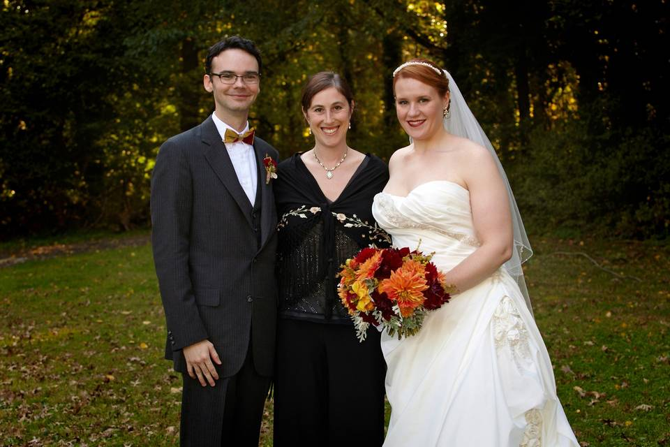 The newlyweds with wedding officiants