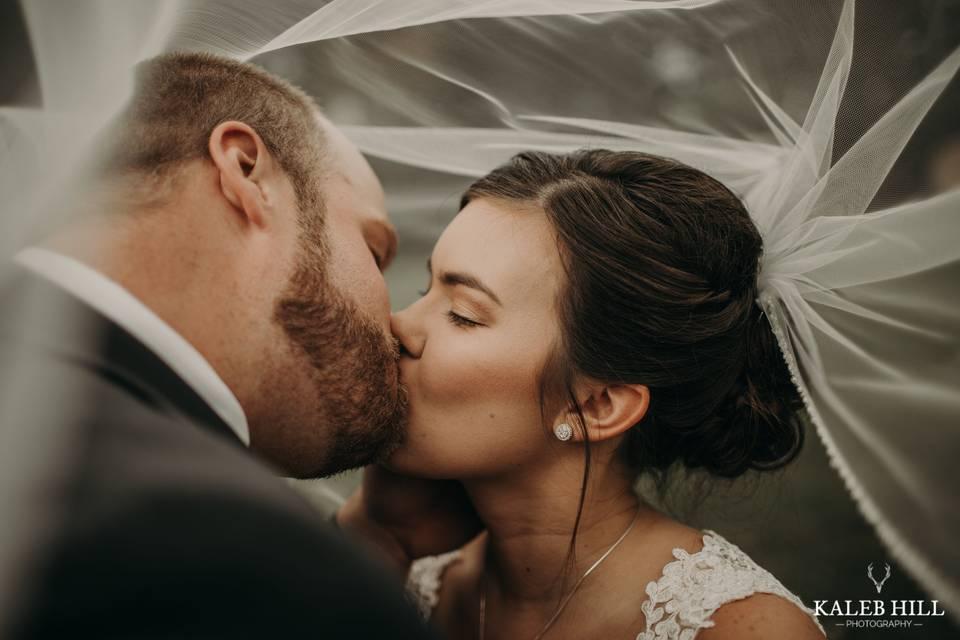 Kiss beneath the veil - Kaleb Hill Photography