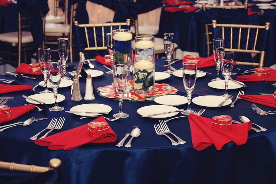 Navy tables with red decor