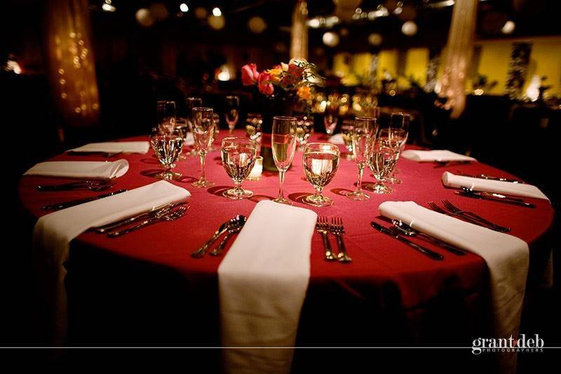 A red and white dining table setup