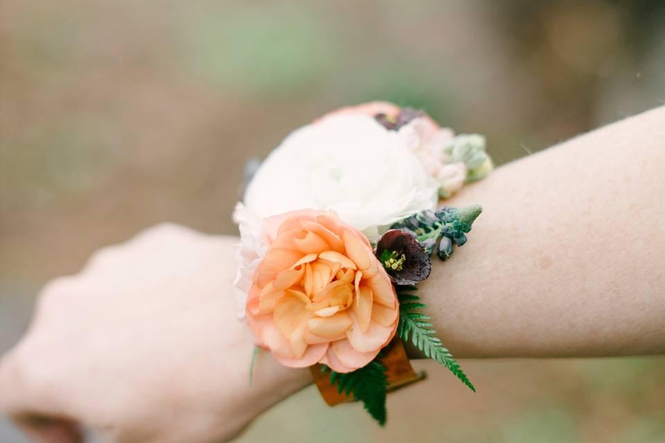Metal wrist cuff corsage
