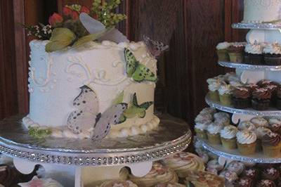 Butterfly cutting cake and cupcake tower