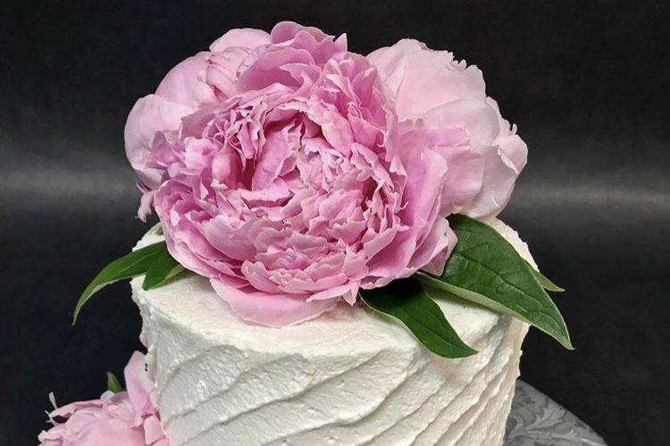 Fresh peonies on a cutting cake