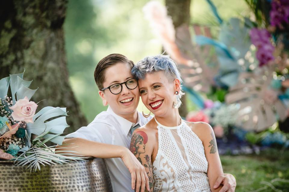 Two brides laughing