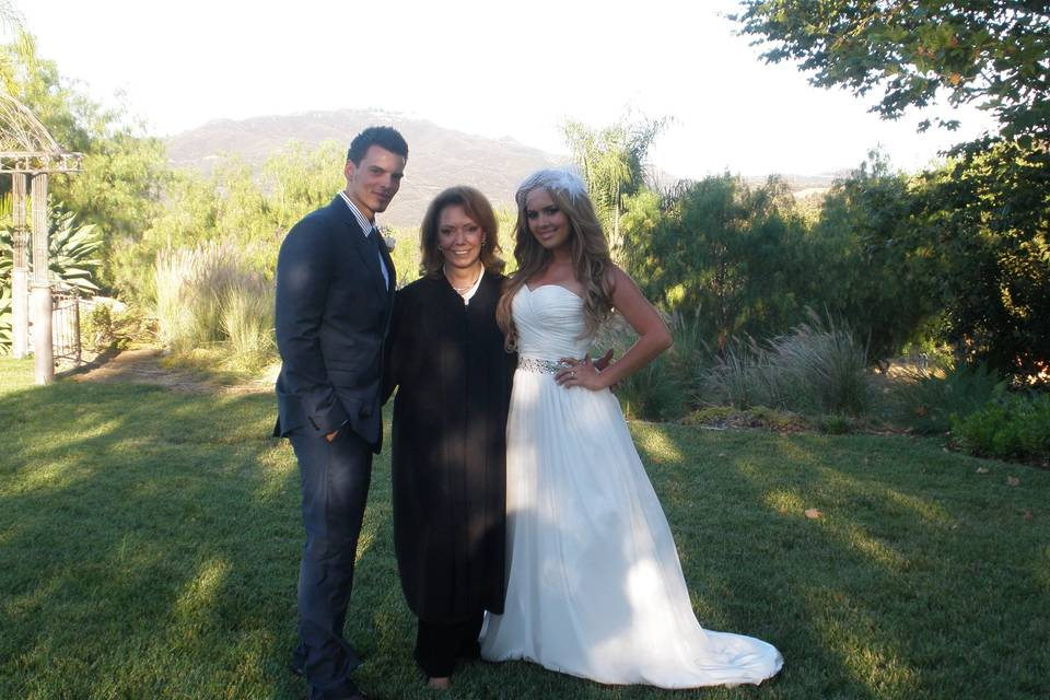 Newlyweds with the reverend
