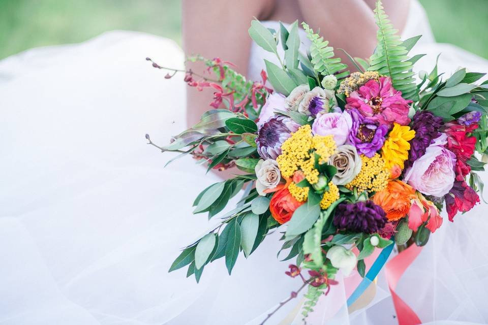 Holding the bright bouquet, Photo Credit: Becky Schwartz Photography