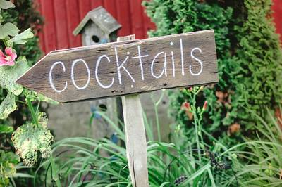 One of our signs leading your guests to the bar that we created in the old corn crib
