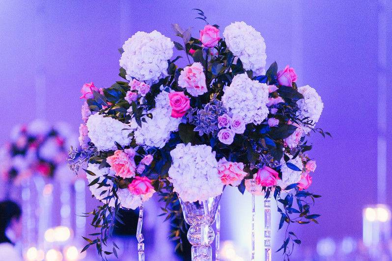Table setup with centerpiece in violet lights