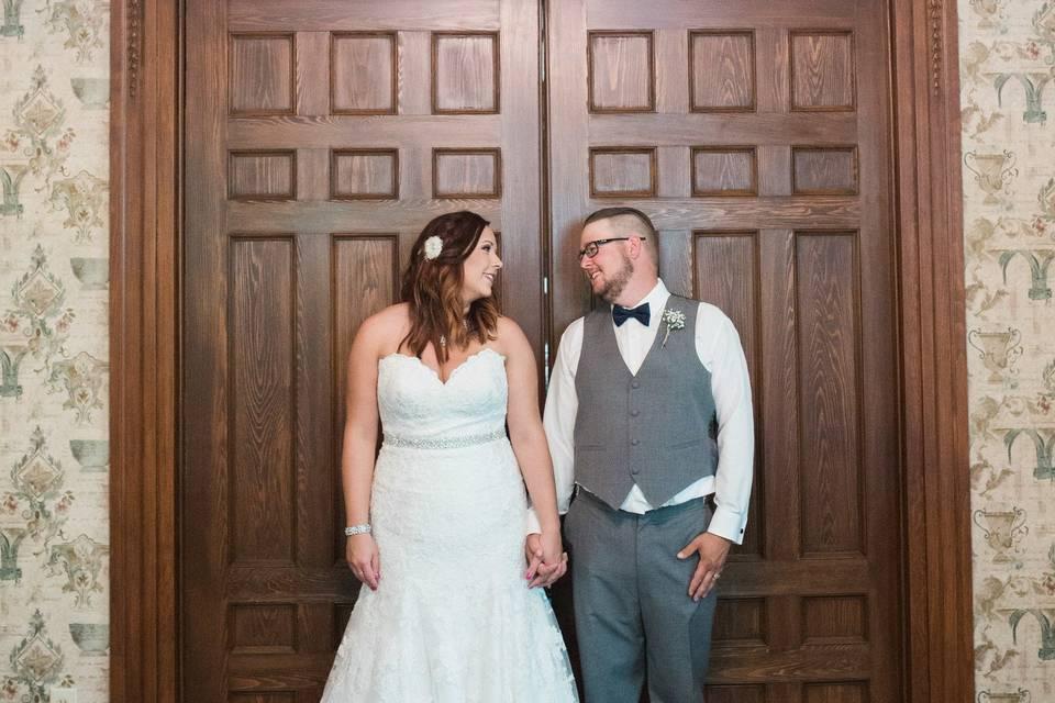 Newlyweds by the door
