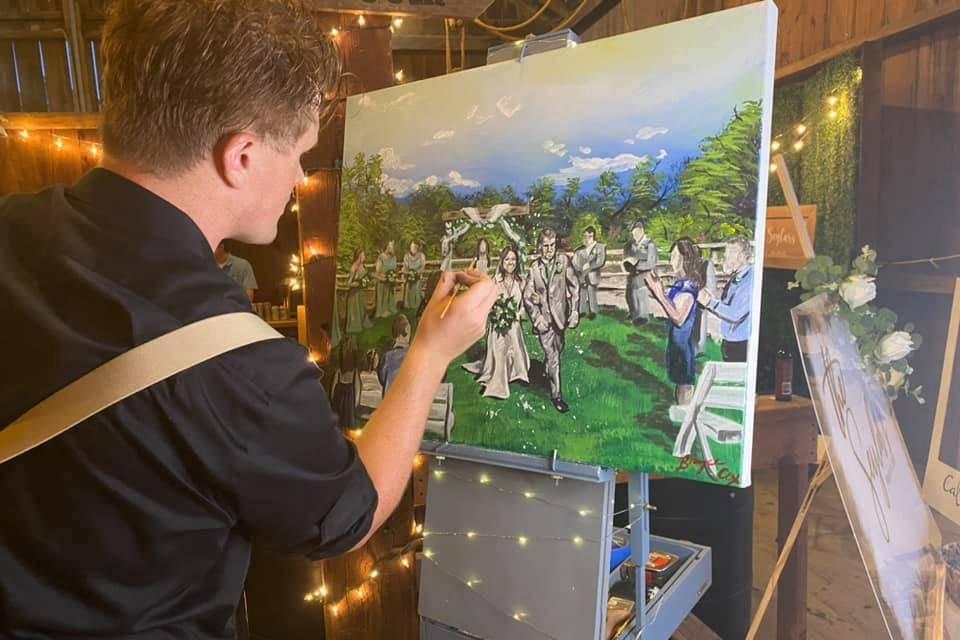 Artist paints a wedding scene