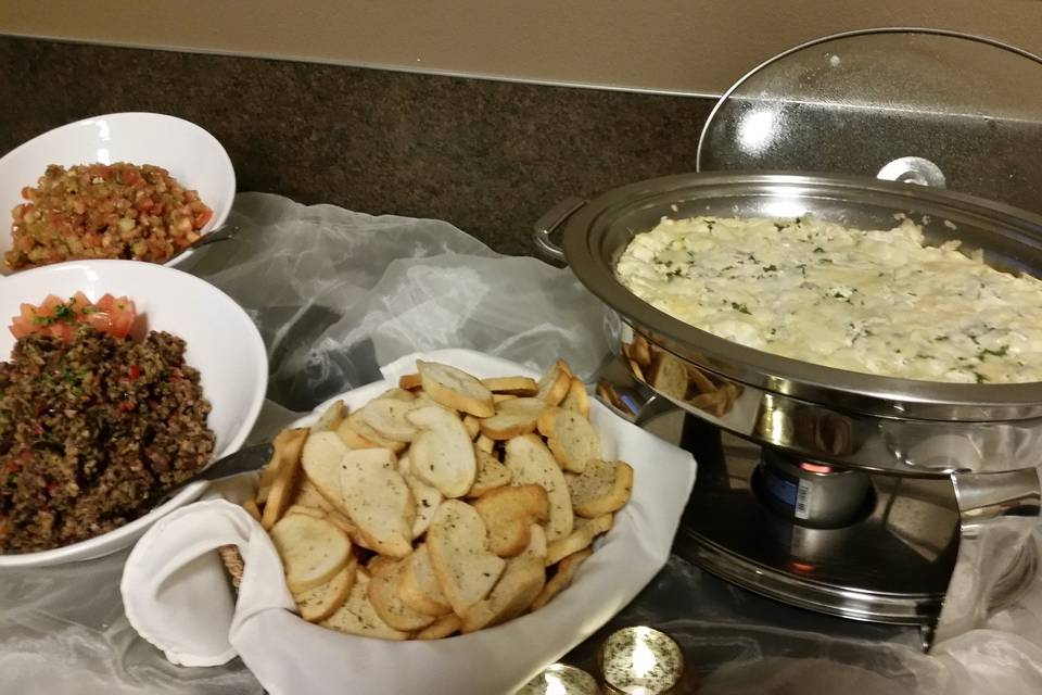 Hot artichoke dip with homemade crostini