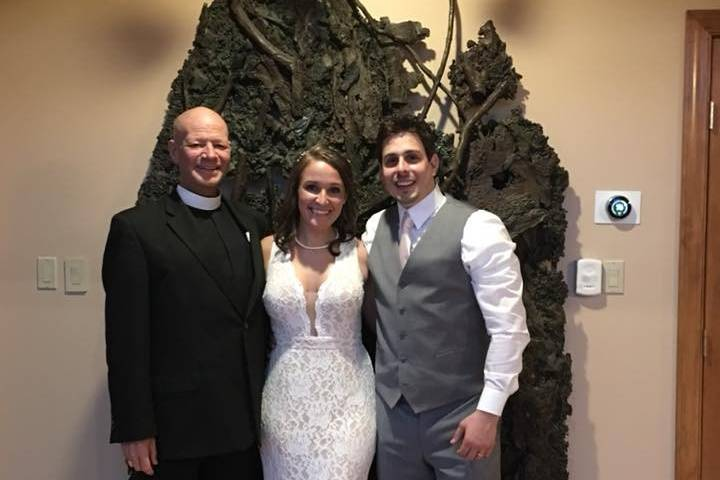 The happy couple with Reverend Rob