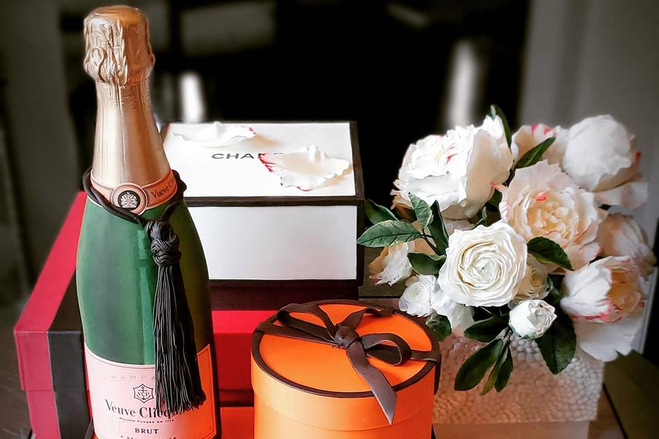 Hermes, Chanel, Veuve, and flowers
