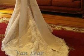French Alencon lace gown with silk satin bow and sash.