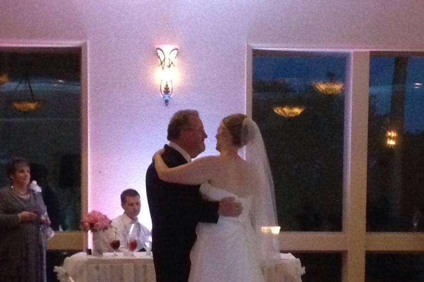 Father-Bride Dance at a wedding at Scenic Hills Country Club in Pensacola. You can see the custom monogram on the dance floor and white up lighting.