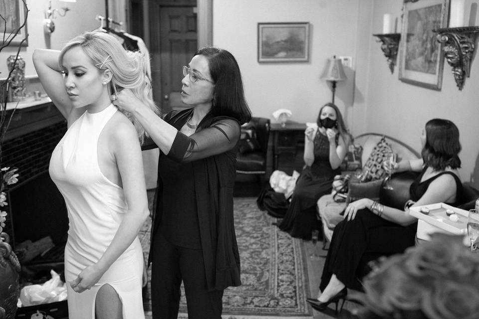 Mother dresses bride - Starke Images