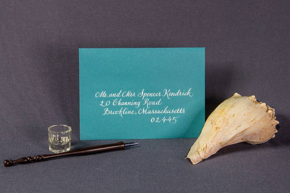 Teal paper white text