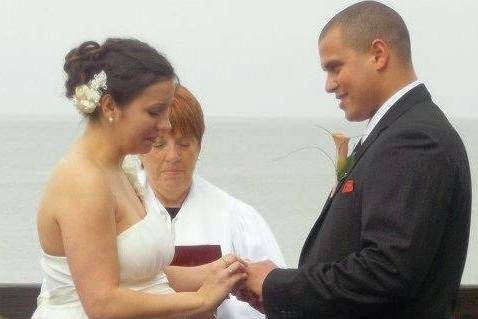 Bride and groom exchanging rings