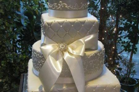 Cake with white ribbons