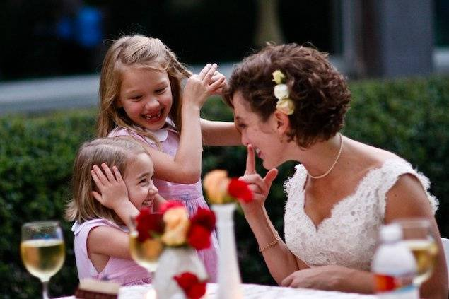 The bride with the kids at the wedding