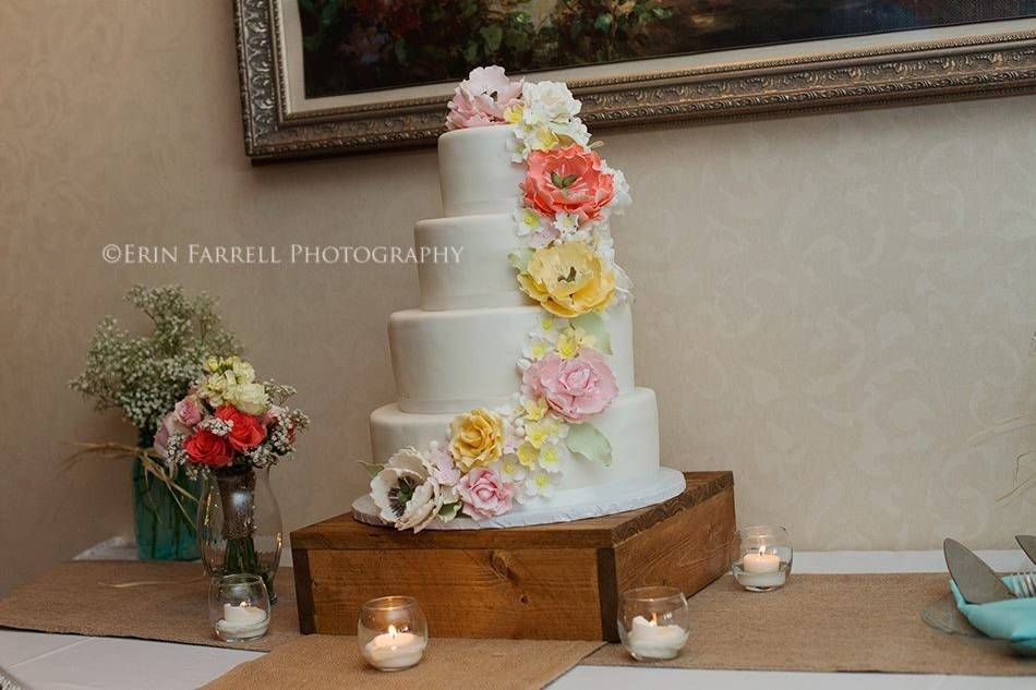 Beautiful sugar flowers cascading down a marshmallow fondant covered cake