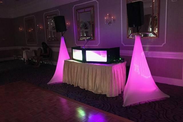 DJ booth with pink lighting