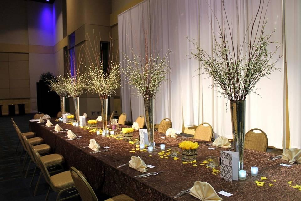 Head Table seating 28.  Mercury Haversham Vases.