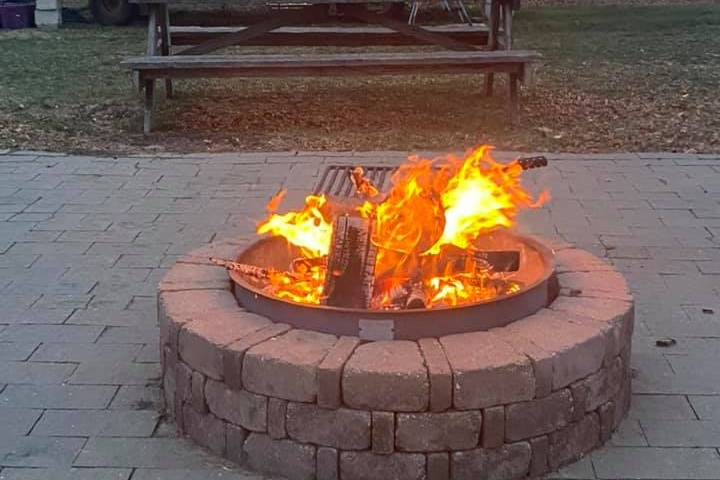 Music on stage by firepit