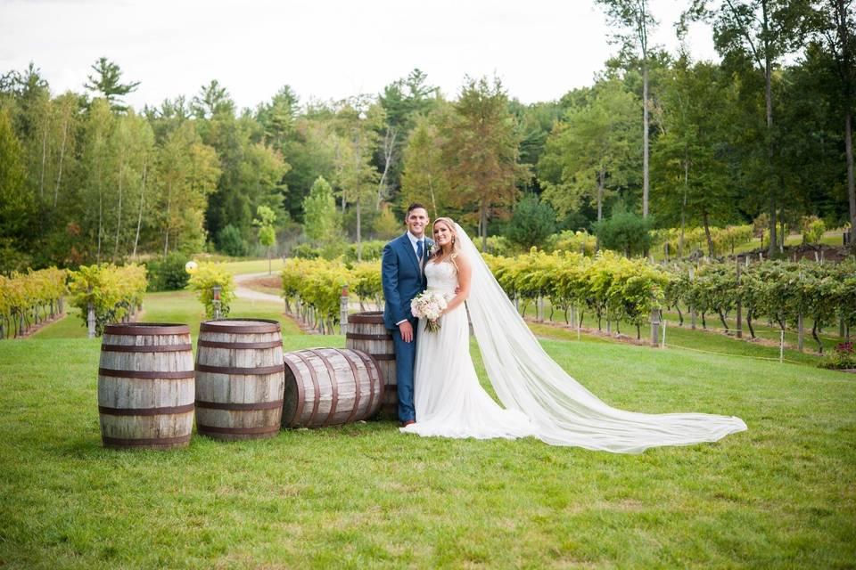 Posing next to authentic wine barrels