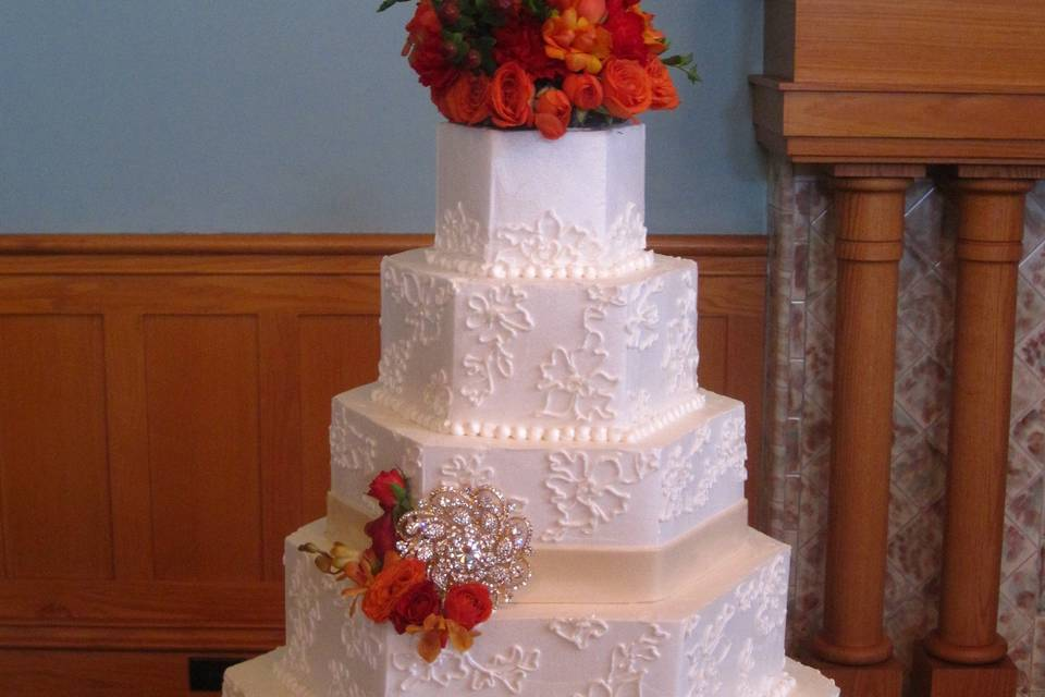Angled cake with flower topper