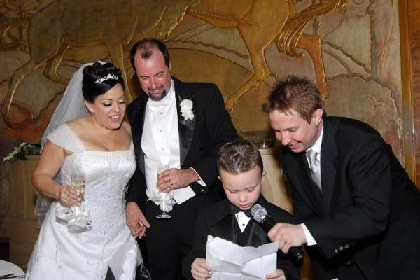 DJ Craig helping the ring bearer with his toast
