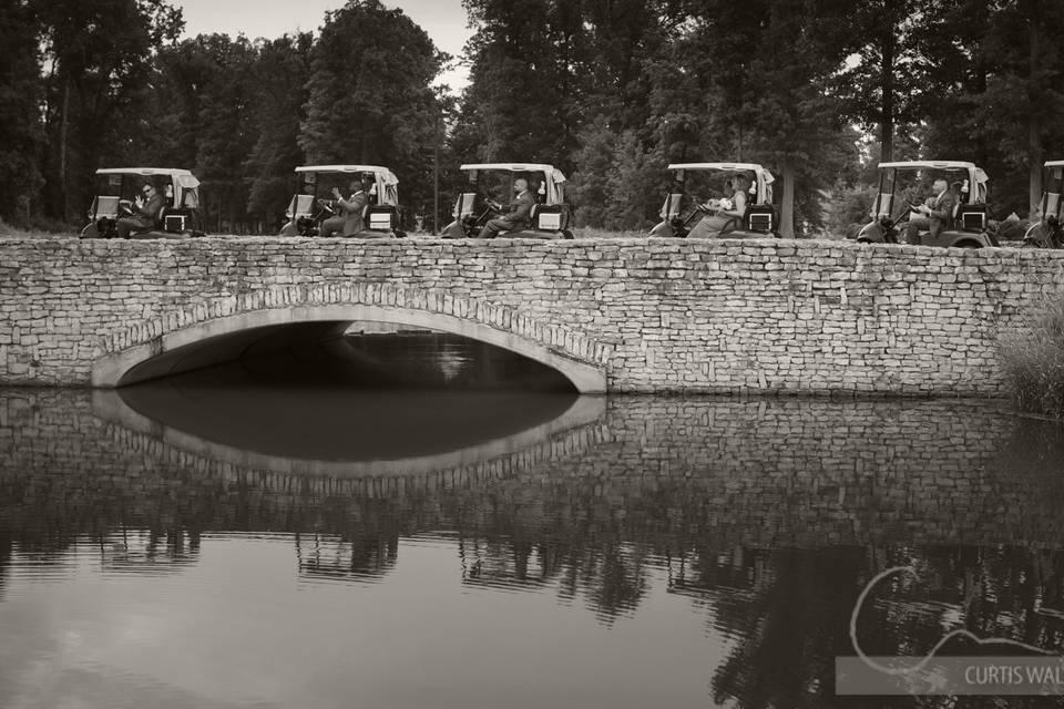 Golf carts on the stone bridge