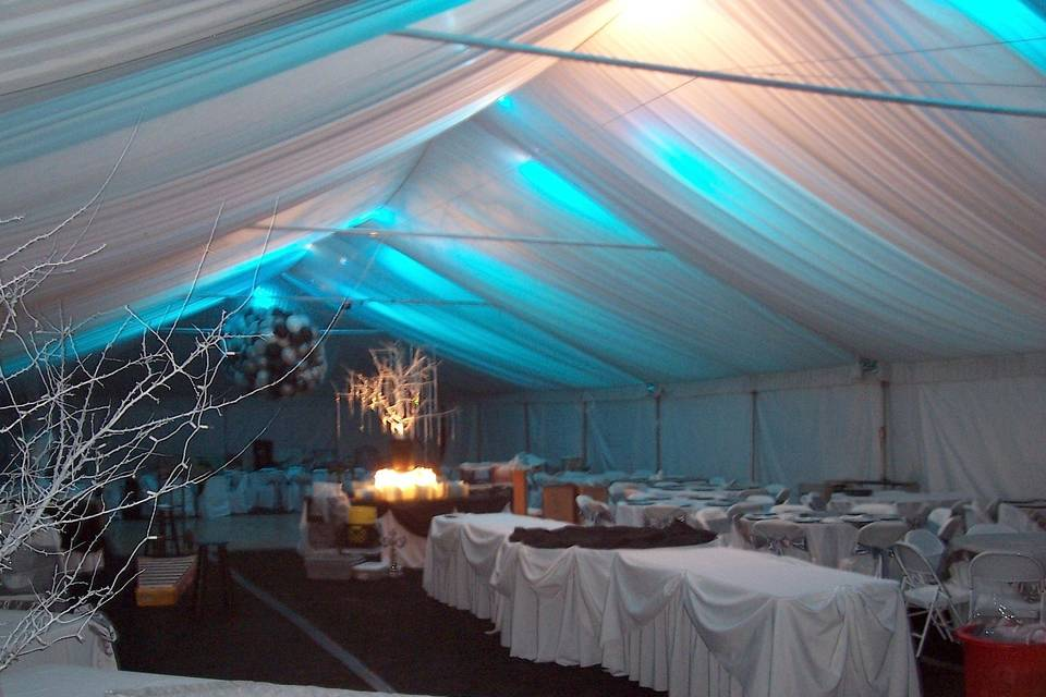 A wedding we set up for in Japser. To create the lighting effect, we used blue bulbs in spotlights placed on the frame, then put the tent liner over it. Very tricky but it made for a ceremony to remember.