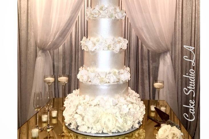 Silver cake with white frosting