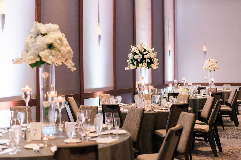 Round tables with white flowers