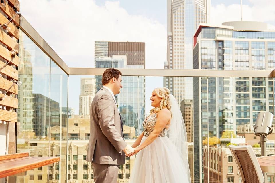 Couple in front of skyscrapers
