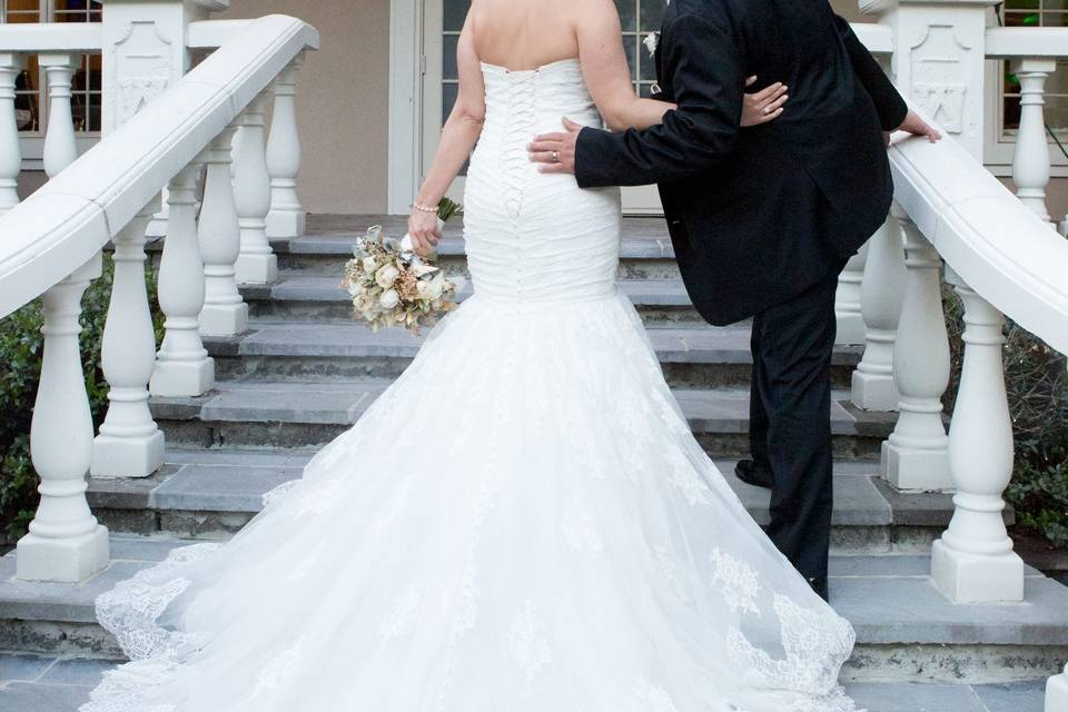 Newlyweds kiss on the stairs