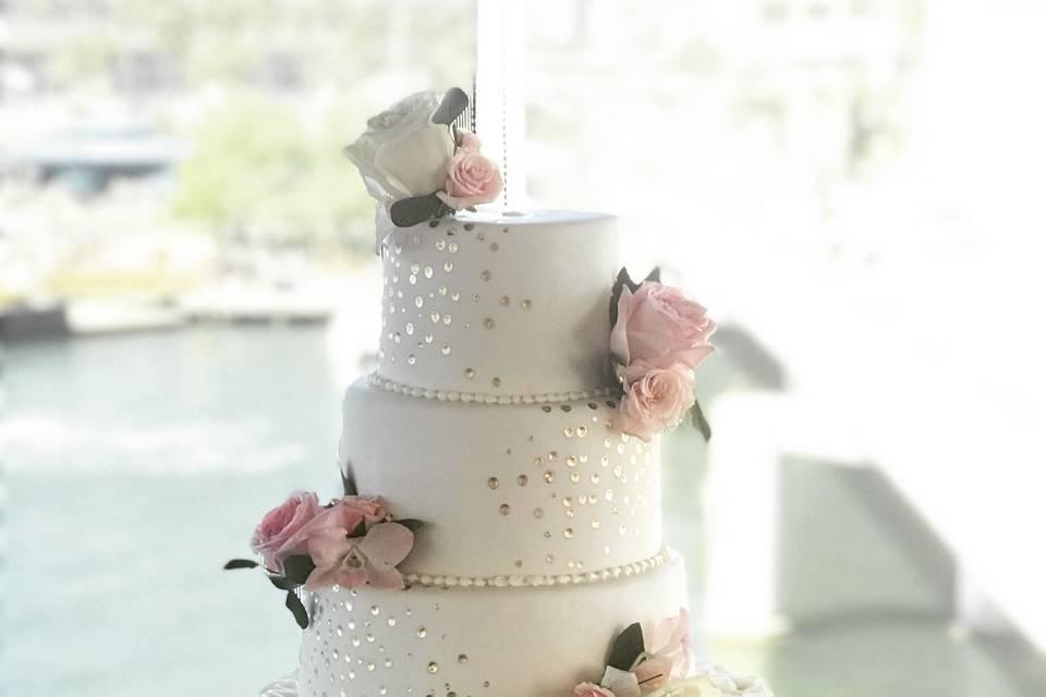 Gold glitter and ruffles wedding cake