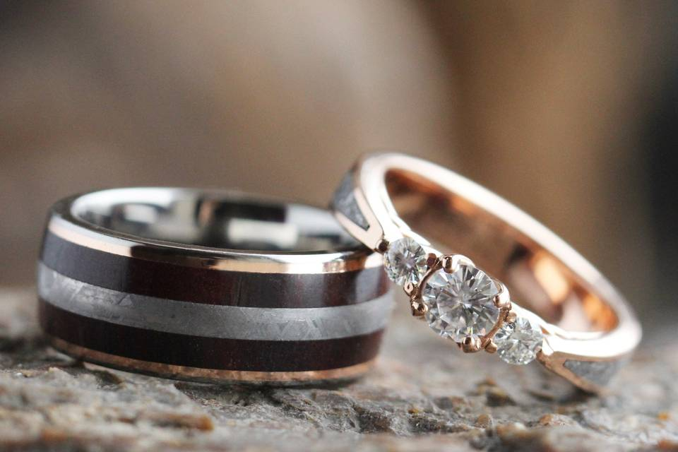 Meteorite and petrified wood wedding band in rose gold (sku 3551) and three stone rose gold engagement ring with meteorite inlay (sku 3546)