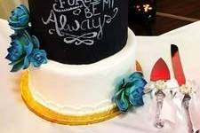 Chalkboard cake with blue flowers